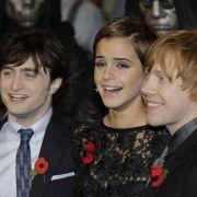 Daniel Radcliffe, Emma Watson und Rupert Grint strahlen bei der Weltpremiere des neuen Harry-Potter-Streifens in die Kameras.