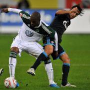 Trotz der Tore von Grafite (links) und Edin Dzeko gab Wolfsburg die Führung noch aus der Hand - ähnlich wie bereits beim 3:4 gegen Mainz und beim 2:3 gegen Leverkusen.