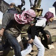 Das beste Nachrichten-Foto machte Yuri Kozyrev aus Russland. Das Bild, das er für das Time Magazine fotografierte zeigt libysche Rebellen.