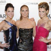 Heidi Klum mit zwei ihrer Schützlinge auf einer New Yorker Gala Anfang Februar 2012.