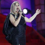 Die schwangere Black-Eyed-Peas-Sängerin Fergie beim Life Ball in Wien - im engen schwarzen Abendkleid.