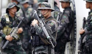 Friedensabkommen: Philippinische Rebellen stimmen Entwaffnung zu (Foto)