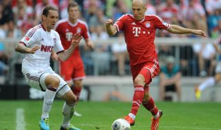 Bayerns Arjen Robben ist wieder fit, Nürnbergs Emanuel Pogatetz (links) steht im Rückspiel nicht im Kader. (Foto)