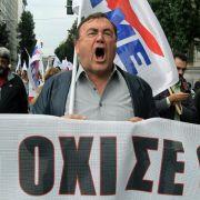 Beschimpfungen für die Troika in Athen (Foto)