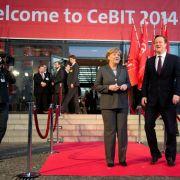 Merkel und Cameron läuten weltgrößte Computermesse CeBIT ein (Foto)