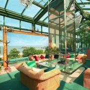 Das Martim Hotel Kaiserhof im Seebad Heringsdorf bietet im Wintergarten einen guten Ausblick auf Strand und Seebrücke des Kaiserbads.