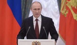 Putin bestreitet Einmischung in der Ukraine (Foto)