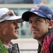 Sebastian Vettel (rechts) ist mit den Gedanken weiter bei Michael Schumacher.