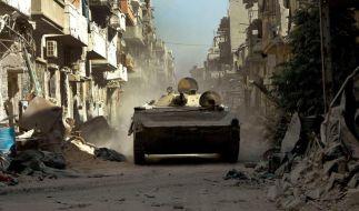 Bitter für Syriens Rebellen: Abzug aus der Altstadt von Homs (Foto)
