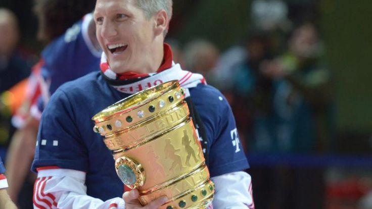 Siebter Pokalsieg:Schweinsteiger zieht an Kahn vorbei (Foto)