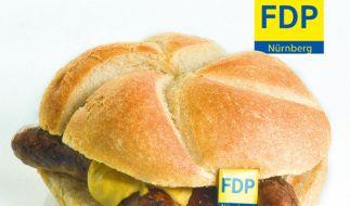 Aus Liebe zur Wurst: Mit dieser landestypischen Spezialität wirbt die FDP Nürnberg um Stimmen bei der Europawahl 2014. (Foto)