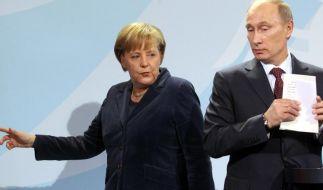 Merkel und Putin treffen sich am Rande der D-Day-Feiern (Foto)