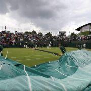 Regen in Wimbledon:LisickisMatch wird zur Hängepartie (Foto)