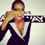 Model Heidi Klum lässt sich auch am Set ihrer Show Project Runway das Feiern in schwarz-rot-gold nicht verbieten.