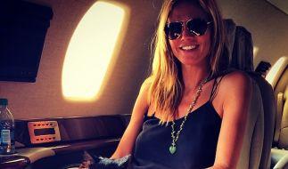 Was für ein Skandal: Heidi Klum fliegt mit einer Katze im Privatjet. (Foto)