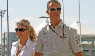 Corinna und Michael Schumacher 2011 in glücklichen Tagen. (Foto)