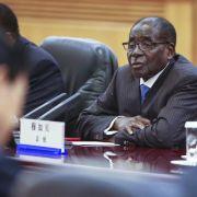 China erneuert Partnerschaft mit Mugabe (Foto)