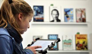 Die Gesetzesänderung in Österreich betrifft auch deutsche Buch-Händler. (Foto)