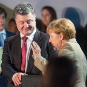 Merkel und Poroschenko: Treffen der Kontaktgruppe wichtig (Foto)