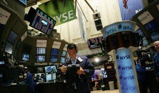 Dow Jones springt erstmals über 18 000 Punkte (Foto)