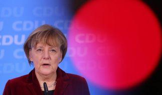 Merkel spricht mit Putin und Poroschenko (Foto)