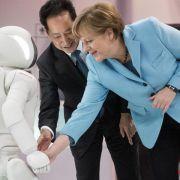 Kanzlerin trifft Roboter Asimo (Foto)