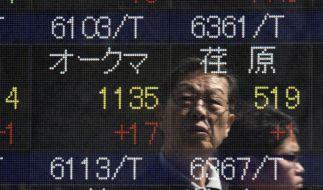 Nikkei nimmt erstmals seit 15 Jahren die 20 000-Punkte-Hürde (Foto)