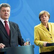 Donbass-Friedensplan: Merkel und Poroschenko fordern Umsetzung (Foto)