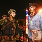 Proteste zum Jahrestag des Militärputsches in Thailand (Foto)