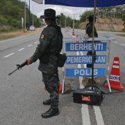 Mehr Massengräber in Malaysia entdeckt (Foto)