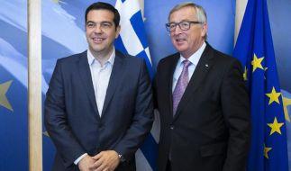 Kommissionspräsident Jean-Claude Juncker (r) mit Alexis Tsipras. (Foto)