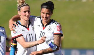 Anja Mittag (L) und Dzsenifer Marozsan wollten im Halbfinale der Frauen-Fußball-WM gegen die USA alles geben. (Foto)