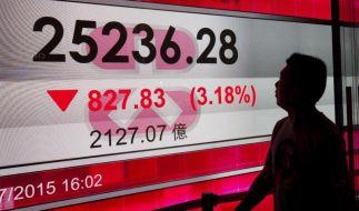 Chinas Börsen rutschen ab - greift die Krise über? (Foto)