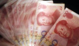 Chinas Zentralbank wertet Yuan kräftig ab (Foto)