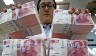 Chinesischer Yuan weiter auf Talfahrt - Dax sackt ab (Foto)