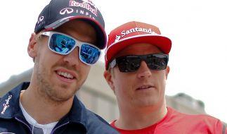 Sebastian Vettel und Kimi Räikkönen bleiben Teamkollegen. (Foto)