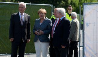 Bundeskanzlerin Angela Merkel besucht Flüchtlingsheim in Heidenau. (Foto)