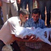 Letztes Geleit für Aylan: Flüchtlingskind in Kobane beerdigt (Foto)