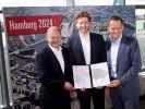Der Hamburger Bürgermeister Olaf Scholz mit den DOSB-Präsidenten Alfons Hörmann (r.) und Nikolas Hill (m.) mit der Bewerbung für Olympia 2024. (Foto)
