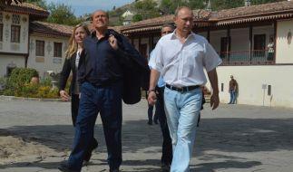 Dicke Freunde: Silvio Berlusconi (links) und Wladimir Putin. (Foto)