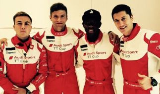 v.l.n.r.: Mario Götze, Thomas Müller, David Alaba und Robert Lewandowski in Formel 1-Kluft. (Foto)