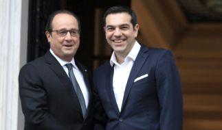 Hollande spricht sich für mehr Solidarität mit dem vom Schulden geplagten Griechenland aus und stellt Tsipras eine Umschuldung in Aussicht. (Foto)