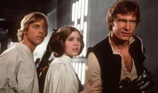 """Luke Skywalker (Mark Hamill, l.), Prinzessin Leia Organa (Carrie Fisher, m.) und Han Solo (Harrison Ford, r.) im letzten Teil der """"Star Wars""""-Saga """"Die Rückkehr der Jedi-Ritter"""". (Foto)"""