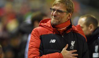 Allen Grund zur Freude: Jürgen Klopp könnte bald seinen ersten Titel in England holen. (Foto)