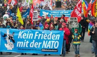 Demonstration von Friedensaktivisten gegen die Münchner Sicherheitskonferenz 2014. (Foto)