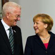 Winfried Kretschmann (Bündnis90/Die Grünen) und Bundeskanzlerin Angela Merkel (CDU) am 03. Oktober 2013 in Stuttgart bei den Feierlichkeiten zum Tag der Deutschen Einheit.