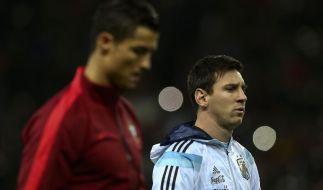 Auf dem Platz seit Jahren Konkurrenten Cristiano Ronaldo (links) und Lionel Messi. (Foto)