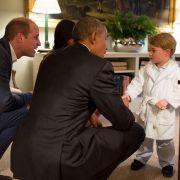 Der kleine George ist ganz erstaunt: Mama Kate und Papa William haben den Präsidenten der Vereinigten Staaten von Amerika und die First Lady zu sich nach Hause eingeladen (April 2016).