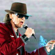 Wer ist der Mann hinter Hut, Brille und Zigarre? (Foto)