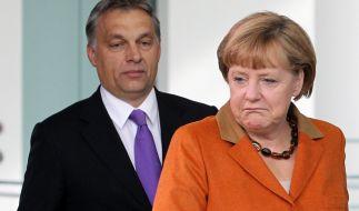 Bundeskanzlerin Angela Merkel (CDU) und der ungarische Ministerpräsident Viktor Orban. (Foto)